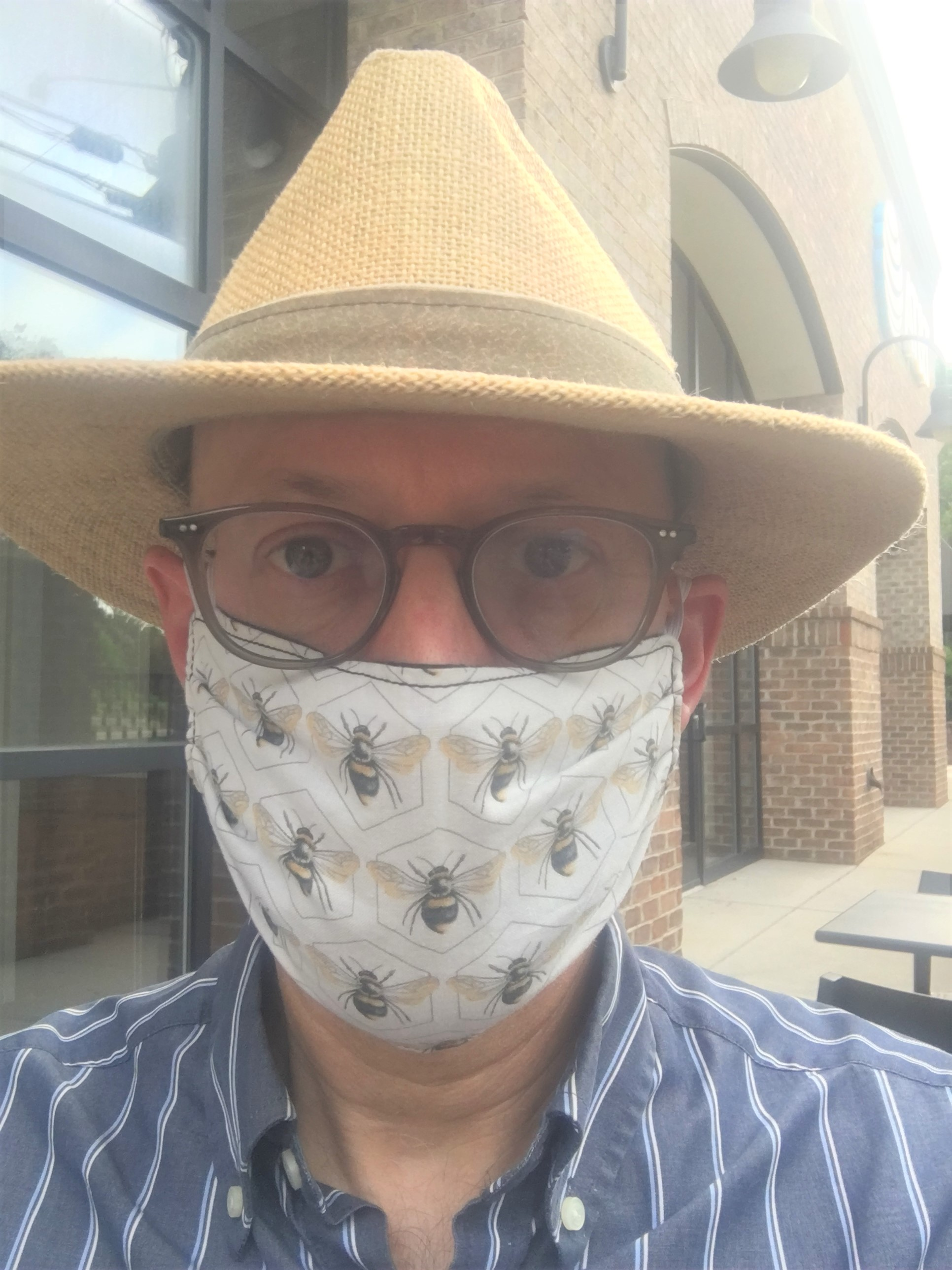 Dr. Paradise with a bee mask and hat